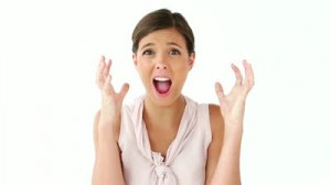 stock-footage-upset-woman-placing-her-hands-on-her-head-against-a-white-background
